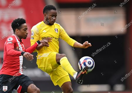 Stock Photo of Fulham's Ademola Lookman, right, duels for the ball with Southampton's Kyle Walker-Peters during the English Premier League soccer match between Southampton and Fulham at St. Mary's Stadium in Southampton, England