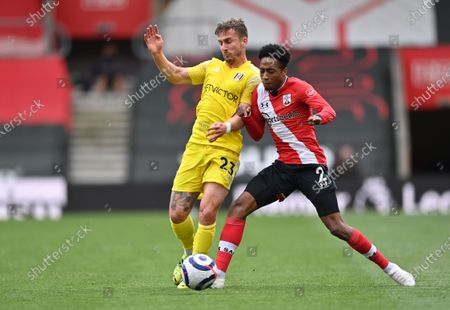 Fulham's Joe Bryan, left, duels for the ball with Southampton's Kyle Walker-Peters during the English Premier League soccer match between Southampton and Fulham at St. Mary's Stadium in Southampton, England