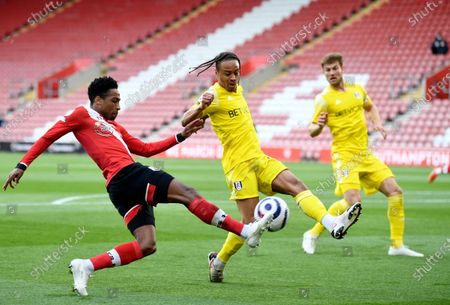 Stock Picture of Fulham's Bobby Decordova-Reid, center, tries to block a shot from Southampton's Kyle Walker-Peters, left, during the English Premier League soccer match between Southampton and Fulham at St. Mary's Stadium in Southampton, England