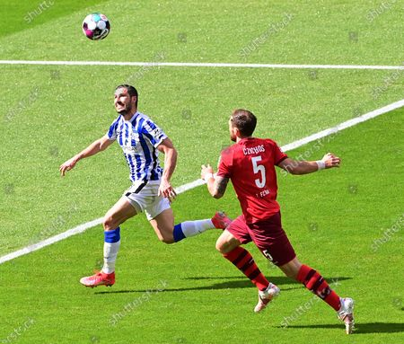 Hertha's Mathew Leckie (L) in action against Cologne's Rafael Czichos (R) during the German Bundesliga soccer match between Hertha BSC Berlin and FC Cologne in Berlin, Germany, 15 May 2021.