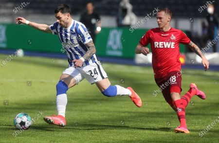 Stock Photo of Hertha's Nemanja Radonjic (L) in action against Cologne's Ondrej Duda (R) during the German Bundesliga soccer match between Hertha BSC Berlin and FC Cologne in Berlin, Germany, 15 May 2021.