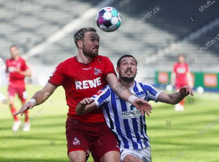 Stock Photo of Cologne's Rafael Czichos (L) in action against Hertha's Mathew Leckie (R) during the German Bundesliga soccer match between Hertha BSC Berlin and FC Cologne in Berlin, Germany, 15 May 2021.