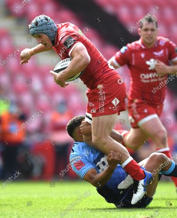 Stock Photo of Jonathan Davies of Scarlets is tackled by Ben Thomas of Cardiff Blues.