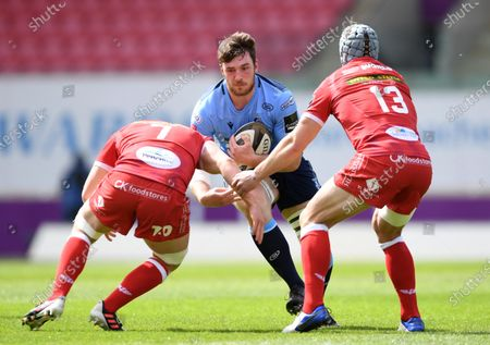 Stock Picture of James Ratti of Cardiff Blues takes on Jac Morgan and Jonathan Davies of Scarlets