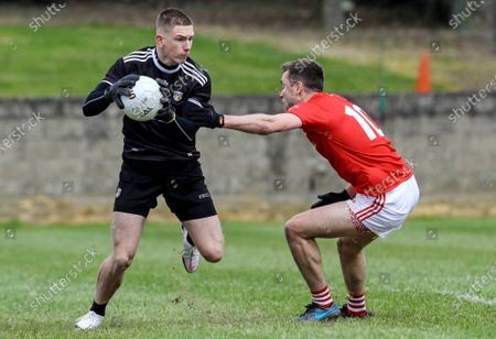 Louth vs Antrim. Louth's Andy McDonnell tackles Michael Byrne of Antrim