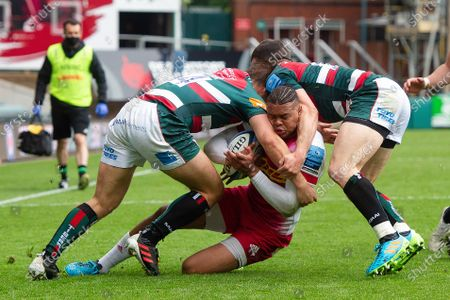 Stock Picture of Nathan Earle of Harlequins is double-tackled