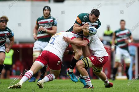 Matt Scott of Leicester Tigers takes on the Harlequins defence
