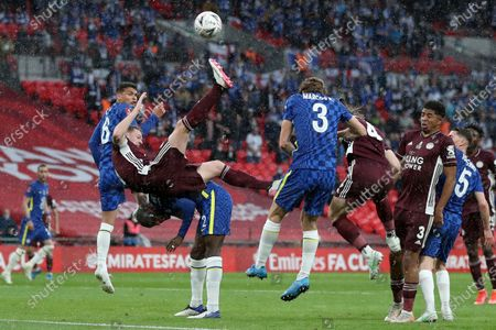 Leicester's Jonny Evans, foreground left, falls on top of Chelsea's Antonio Rudiger during the FA Cup final soccer match between Chelsea and Leicester City at Wembley Stadium in London, England
