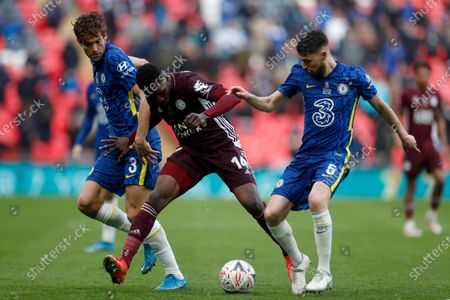 Leicester's Kelechi Iheanacho vies for the ball with Chelsea's Jorginho and Marcos Alonso, left, during the FA Cup final soccer match between Chelsea and Leicester City at Wembley Stadium in London, England