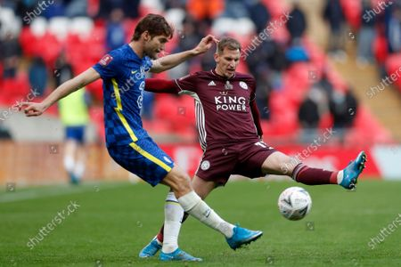 Leicester's Marc Albrighton tries to block a shot from Chelsea's Marcos Alonso, left, during the FA Cup final soccer match between Chelsea and Leicester City at Wembley Stadium in London, England