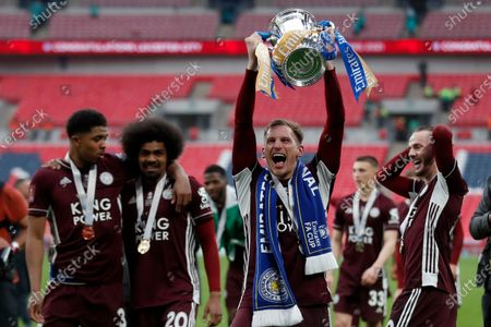 Leicester's Marc Albrighton celebrates with the trophy after winning the FA Cup final soccer match between Chelsea and Leicester City at Wembley Stadium in London, England, . Leicester won 1-0