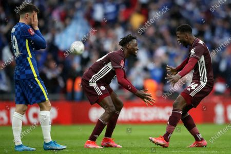 Leicester's Kelechi Iheanacho, right, and Wilfred Ndidi celebrate while Chelsea's Mason Mount, left, reacts at the end of the FA Cup final soccer match between Chelsea and Leicester City at Wembley Stadium in London, England, . Leicester won 1-0