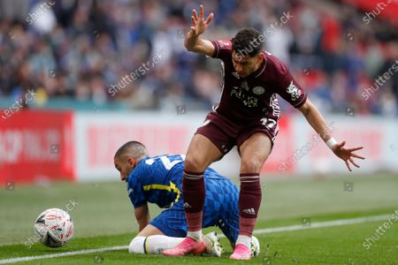 Leicester's Ayoze Perez vies for the ball with Chelsea's Hakim Ziyech, left, during the FA Cup final soccer match between Chelsea and Leicester City at Wembley Stadium in London, England