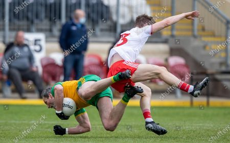Tyrone vs Donegal. Tyrone's Kieran McGeary with Michael Murphy of Donegal