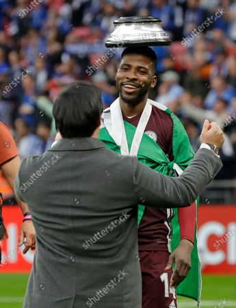 Leicester's Kelechi Iheanacho celebrates with chairman Aiyawatt Srivaddhanaprabha at the end of the FA Cup final soccer match between Chelsea and Leicester City at Wembley Stadium in London, England, . Leicester won the match 1-0