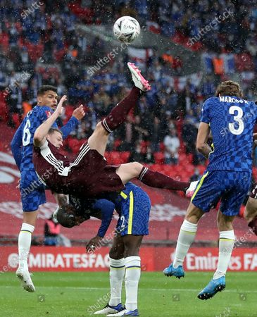Stock Photo of Jonny Evans (up C) of Leicester in action against Antonio Ruediger (bottom C) of Chelsea during the English FA Cup final between Chelsea FC and Leicester City at the Wembley Stadium in London, Britain, 15 May 2021.