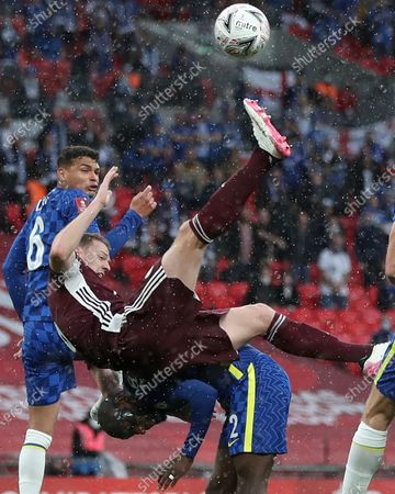 Stock Image of Jonny Evans (C) of Leicester in action against Antonio Ruediger (bottom) of Chelsea during the English FA Cup final between Chelsea FC and Leicester City at the Wembley Stadium in London, Britain, 15 May 2021.