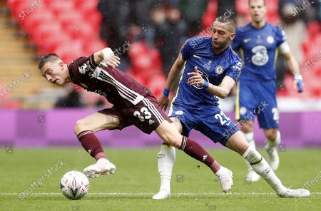 Hakim Ziyech (R) of Chelsea in action against Luke Thomas of Leicester during the English FA Cup final between Chelsea FC and Leicester City at the Wembley Stadium in London, Britain, 15 May 2021.