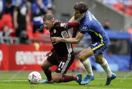 Marcos Alonso (R) of Chelsea in action against Marc Albrighton of Leicester during the English FA Cup final between Chelsea FC and Leicester City at the Wembley Stadium in London, Britain, 15 May 2021.