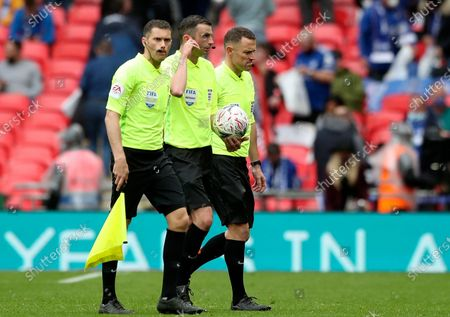 Referee Michael Oliver (C) and his assistants leave the pitch at halftime of the English FA Cup final between Chelsea FC and Leicester City at the Wembley Stadium in London, Britain, 15 May 2021.