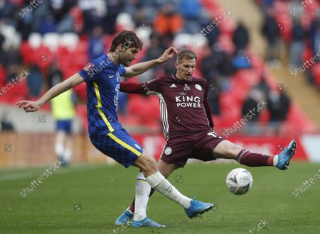 Chelsea's Marcos Alonso (L) in action against Leicester's Marc Albrighton (R) during the English FA Cup final between Chelsea FC and Leicester City at the Wembley Stadium in London, Britain, 15 May 2021.