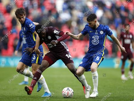Leicester's Kelechi Iheanacho (C) in action against Chelsea players Marcos Alonso (L) and Jorginho (R) during the English FA Cup final between Chelsea FC and Leicester City at the Wembley Stadium in London, Britain, 15 May 2021.