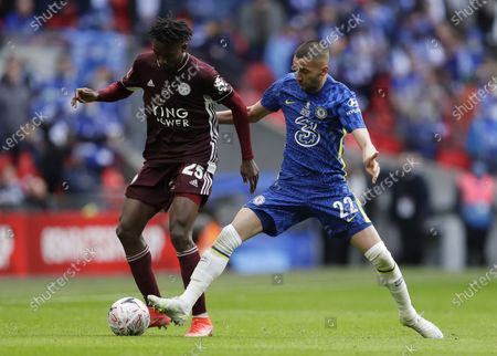 Leicester's Wilfred Ndidi (L) in action against Chelsea's Hakim Ziyech (R) during the English FA Cup final between Chelsea FC and Leicester City at the Wembley Stadium in London, Britain, 15 May 2021.