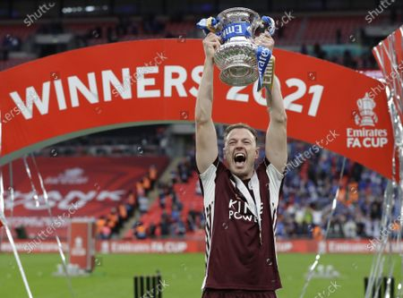 Leicester's Jonny Evans celebrates with the trophy after winning the English FA Cup final between Chelsea FC and Leicester City at the Wembley Stadium in London, Britain, 15 May 2021.