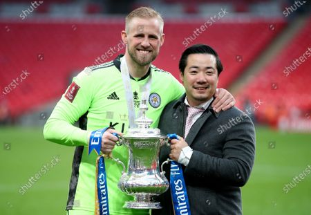Leicester City chairman Aiyawatt Srivaddhanaprabha (R) and goalkeeper Kasper Schmeichel (L) celebrate with the trophy after winning the English FA Cup final between Chelsea FC and Leicester City at the Wembley Stadium in London, Britain, 15 May 2021.