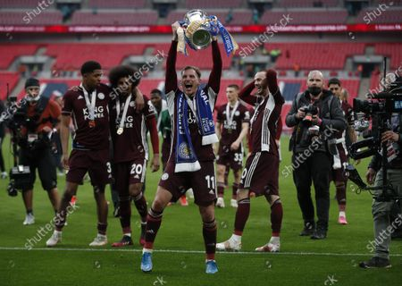 Leicester's Marc Albrighton (C) celebrates with the trophy after the English FA Cup final between Chelsea FC and Leicester City at the Wembley Stadium in London, Britain, 15 May 2021. Leicester won 1-0.