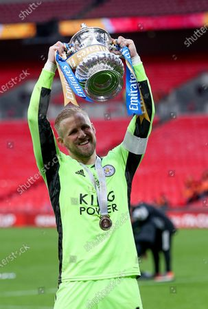 Leicester's goalkeeper Kasper Schmeichel celebrates with the trophy after winning the English FA Cup final between Chelsea FC and Leicester City at the Wembley Stadium in London, Britain, 15 May 2021.