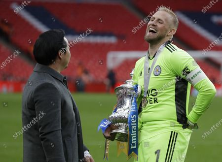 Leicester City chairman Khun Aiyawatt Srivaddhanaprabha (L) and goalkeeper Kasper Schmeichel (R) celebrate with the trophy after the English FA Cup final between Chelsea FC and Leicester City at the Wembley Stadium in London, Britain, 15 May 2021. Leicester won 1-0.