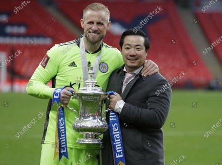 Leicester City chairman Khun Aiyawatt Srivaddhanaprabha (R) and goalkeeper Kasper Schmeichel (L) celebrate with the trophy after the English FA Cup final between Chelsea FC and Leicester City at the Wembley Stadium in London, Britain, 15 May 2021. Leicester won 1-0.