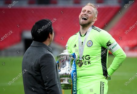 Leicester City chairman Aiyawatt Srivaddhanaprabha (L) and goalkeeper Kasper Schmeichel (R) celebrate with the trophy after winning the English FA Cup final between Chelsea FC and Leicester City at the Wembley Stadium in London, Britain, 15 May 2021.