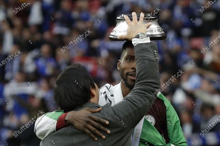 Stock Photo of Leicester City chairman Khun Aiyawatt Srivaddhanaprabha (L) and Kelechi Iheanacho (R) celebrate after the English FA Cup final between Chelsea FC and Leicester City at the Wembley Stadium in London, Britain, 15 May 2021. Leicester won 1-0.