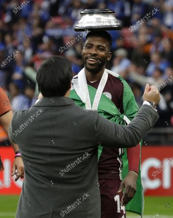 Leicester City chairman Khun Aiyawatt Srivaddhanaprabha (L) and Kelechi Iheanacho (R) celebrate after the English FA Cup final between Chelsea FC and Leicester City at the Wembley Stadium in London, Britain, 15 May 2021. Leicester won 1-0.