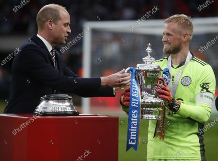 Britain's Prince William, Duke of Cambridge, (L) presents the trophy to Leicester goalkeeper Kasper Schmeichel (R) after the English FA Cup final between Chelsea FC and Leicester City at the Wembley Stadium in London, Britain, 15 May 2021. Leicester won 1-0.