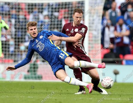 Jonny Evans of Leicester City tackles Timo Werner of Chelsea