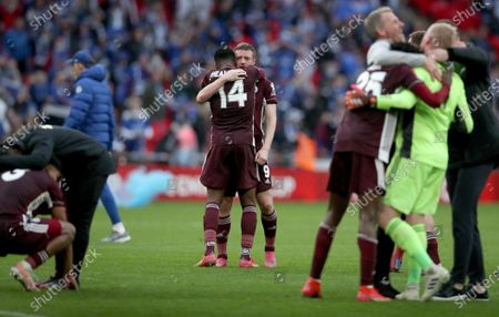 Jamie Vardy of Leicester City hugs teammate Kelechi Iheanacho and looks emotional at the final whistle