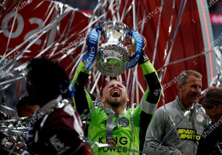 Kasper Schmeichel the Leicester City captain holds aloft the FA Cup