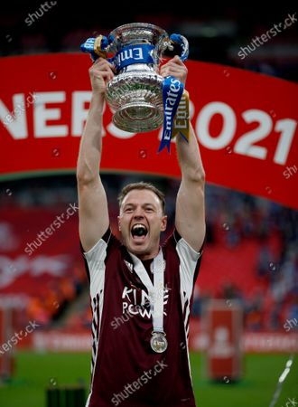 Jonny Evans of Leicester City holds aloft the FA Cup and celebrates