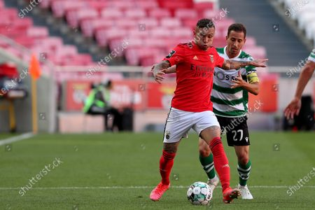 Everton of SL Benfica (L) vies with Joao Pereira of Sporting CP during the Portuguese League football match between SL Benfica and Sporting CP at the Luz stadium in Lisbon, Portugal on May 15, 2021.