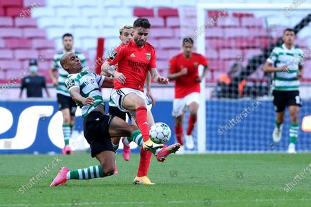 Joao Mario of Sporting CP (L) vies with Rafa Silva of SL Benfica during the Portuguese League football match between SL Benfica and Sporting CP at the Luz stadium in Lisbon, Portugal on May 15, 2021.
