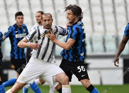 Giorgio Chiellini of Juventus FC fights for the ball against Matteo Darmian of FC Internazionale