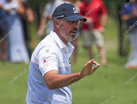 Matt Kuchar of the US holds up his ball after putting on the fifth green during the third round of the AT&T Byron Nelson golf tournament at TPC Craig Ranch in McKinney, Texas, USA, 15 May 2021. The tournament is being played 13 May through 16 May.