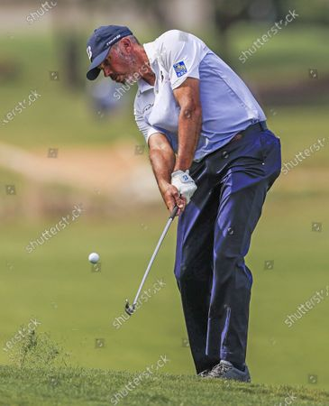 Matt Kuchar of the US hits his second shot on the sixteenth hole during the third round of the AT&T Byron Nelson golf tournament at TPC Craig Ranch in McKinney, Texas, USA, 15 May 2021. The tournament is being played 13 May through 16 May.