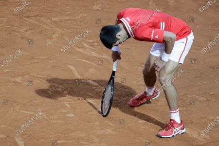 Stock Picture of Serbia's Novak Djokovic reacts as he plays Italy's Lorenzo Sonego during their semi-final match at the Italian Open tennis tournament, in Rome