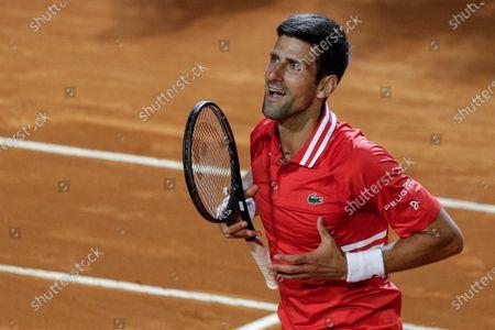 Stock Photo of Serbia's Novak Djokovic celebrates after beating Italy's Lorenzo Sonego in their semi-final match at the Italian Open tennis tournament, in Rome, . Djokovic won 6-3 6-7 6-2