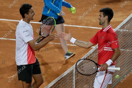 Serbia's Novak Djokovic, right, greets Italy's Lorenzo Sonego after their semi-final match at the Italian Open tennis tournament, in Rome, . Djokovic won 6-3 6-7 6-2