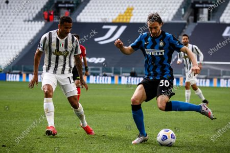 Inter defender Matteo Darmian (36) fights for the ball against Juventus defender Danilo (13) during the Serie A football match n.37 JUVENTUS - INTER on May 15, 2021 at the Allianz Stadium in Turin, Piedmont, Italy. Final result: Juventus-Inter 3-2. Sporting stadiums around Italy remain under strict restrictions due to the Coronavirus Pandemic as Government social distancing laws prohibit fans inside venues resulting in games being played behind closed doors.